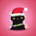Christmas black cat with garland and santa hat Royalty Free Stock Photo