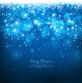 Christmas blue background with falling snowflakes Royalty Free Stock Photos