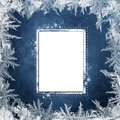 Christmas blue background with frosty patterns and card for text or photo