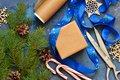 Christmas blue background with gift boxes and xmas tree. Royalty Free Stock Photo