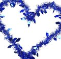 Christmas blue tinsel in form of heart whole background Stock Photos