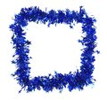 Christmas blue tinsel with stars as frame. Royalty Free Stock Photo