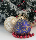 Christmas blue and white ball sitting on small red docorative balls close up Royalty Free Stock Photo
