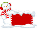 Christmas board and snowmen cute near snowbound Stock Photos