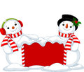 Christmas board and two snowmen cute near snowbound Royalty Free Stock Photo
