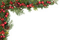 Christmas border background with red baubles holly mistletoe ivy and winter greenery over white Stock Photo
