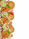 Christmas border of gingerbread men and candies Royalty Free Stock Photo
