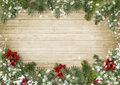 Christmas border with poinsettia onold wood background Royalty Free Stock Photo