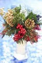 Christmas bouquet beautiful in vase on blue background Stock Photography