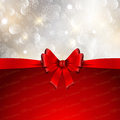 Christmas bow background decorative with a glossy red and snowflakes design Royalty Free Stock Image
