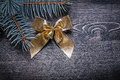Christmas bow pine tree branch on wooden board holiday concept Royalty Free Stock Images