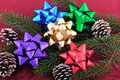 Christmas Bows Evergreen Branch and Pine Cones Stock Photos