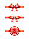 Christmas bows a set of three glossy red and gold ribbons and Royalty Free Stock Photography