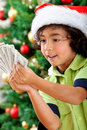 Christmas boy with money Stock Image