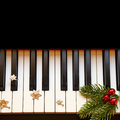 Christmas branch on piano Royalty Free Stock Photo