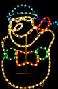 Christmas brightly colored outdoor snowman lights an decoration of a jolly fat done in sparkling multicolored bright flashing that Royalty Free Stock Photography