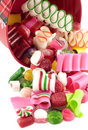 Christmas Bucket with Candy Spilling Out Stock Image