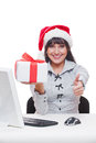 Christmas businesswoman holding gift Royalty Free Stock Images