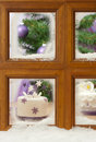 Christmas Cake In Frosty Window Royalty Free Stock Photo