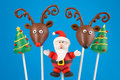 Christmas cake pops santa claus reindeer and trees mini cakes on stick dipped in chocolate and decorated with fondant Stock Photos