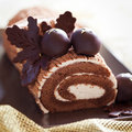 Christmas cake traditional decorated with chocolate chestnuts selective focus Stock Photo