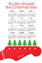 Christmas calendar with guitar and text rockin around the tree Royalty Free Stock Photo