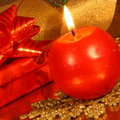 Christmas candle card stock photo red ball on gold blur background Royalty Free Stock Photography