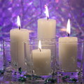 Christmas candle card stock photos candlelight of white candles on blue purple background Stock Photos