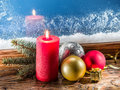 Christmas candle, Christmas balls and frozen window. Royalty Free Stock Photo