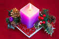 Christmas candle with decorations on the table Royalty Free Stock Photography