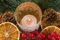 Christmas candle dried orange slices and pine branch for decoration Royalty Free Stock Photo