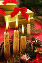 Christmas candle and gifts Stock Image