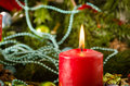 Christmas candle gifts pine cones close up Royalty Free Stock Photo