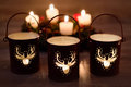 Christmas candle holders on wooden background Royalty Free Stock Photo