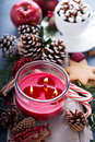 Christmas candle with hot chocolate and ornaments Royalty Free Stock Photo