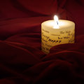 Christmas candle photo of a on red background Royalty Free Stock Photography