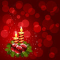Christmas candle on red background Royalty Free Stock Images