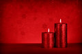 Christmas candle red with red background Royalty Free Stock Images
