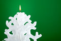 Christmas candle shaped like a christmas tree on green background Stock Photo
