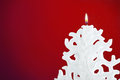 Christmas candle shaped like a christmas tree on red background Royalty Free Stock Image