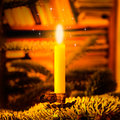 Christmas candle on a tree with sparkling light Stock Photo