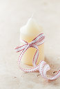 Christmas candle white with ribbon Royalty Free Stock Photo