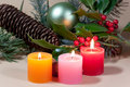 Christmas candles and baubles on background Royalty Free Stock Photos