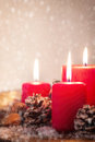 Christmas candles with christmas decorations, christmas or new year atmosphere Royalty Free Stock Photo