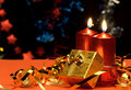 Christmas candles and gift boxes Stock Photography