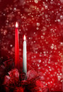 Christmas candles a red and white candle with flame and red bows at the base concept Royalty Free Stock Photo