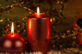 Christmas candles set against black background Stock Images