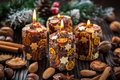 Christmas candles with spices and nuts Royalty Free Stock Photo