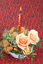Christmas candlestick with fresh flowers Stock Image