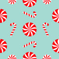 Christmas Candy Cane Round white and red sweet set. Seamless Pattern Decoration. Wrapping paper, textile template. Blue background Royalty Free Stock Photo